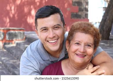 Hispanic senior woman with her son