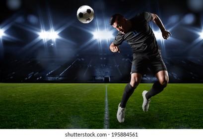 Hispanic Soccer Player heading the ball