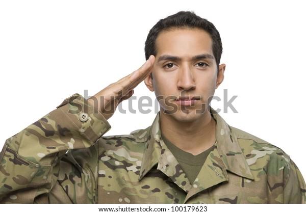 Hispanic Soldier salutes on white background