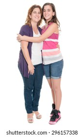Hispanic teenage girl hugging her mother isolated on a white background