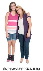 Hispanic teenage girl hugs her mother isolated on a white background