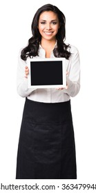 Hispanic waitress in her twenties showing blank digital tablet computer isolated on white background