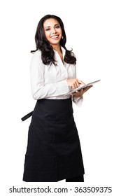 Hispanic waitress in her twenties taking order on digital tablet computer isolated on white background