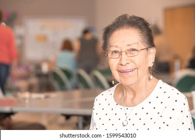Hispanic woman in a busy senior center
