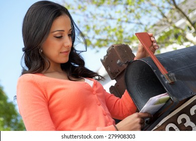 Hispanic Woman Checking Mailbox