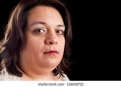 hispanic woman crying on a black background