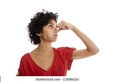 hispanic woman holding breath closing nose with fingers on white background