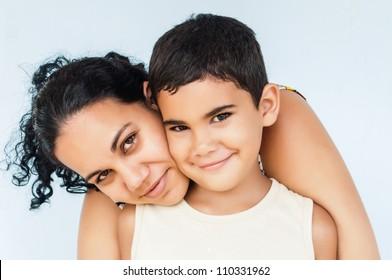 Hispanic woman hugging her young son