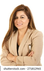Hispanic Woman on white Background with Business Suit holding Glasses.  Her arms are folded and she's smiling softly