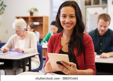 Hispanic woman with tablet computer at an adult education class