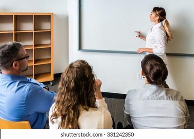 Hispanic woman teaching a class