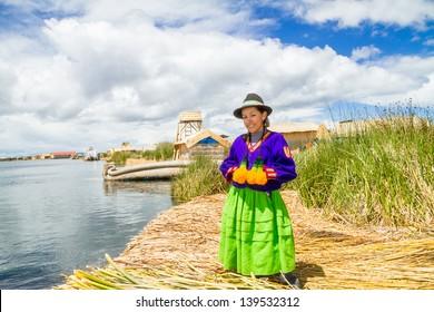Hispanic woman in traditional indigenous clothing, Puno, Uros islands, Peru