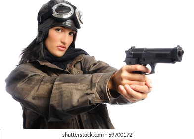 Hispanic woman in a vintage aviator costume holding a gun on a white background