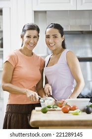 Hispanic women chopping vegetables