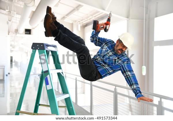 Hispanic worker falling from ladder inside building