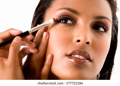 Hispanicelegant woman with a brush
