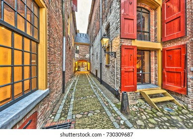 Historic alley with windows and red hatches in Groningen city Netherlands