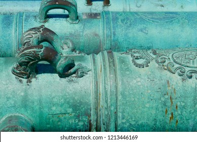 Historic, ancient, turquoise, decorative cannons close up on the Castillo de San Marcos National Monument in St. Augustine, Florida, United States.