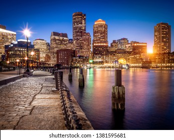 The historic architecture of Boston in Massachusetts, USA at sunset showcasing the Boston Harbor and Financial District.