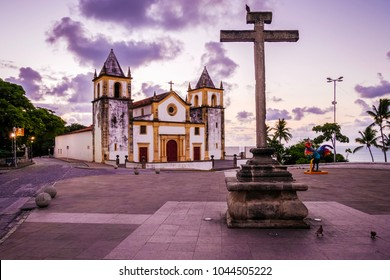 The historic architecture of Olinda in Pernambuco, Brazil at sunrise showcasing its cobblestone street and buildings dated from the 17th century.