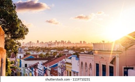 The historic architecture of Olinda in Pernambuco, Brazil with its colonial buildings and cobblestone streets at sunset.