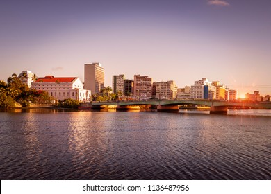 The historic architecture of Recife in the state of Pernambuco, Brazil by the Capibaribe river at sunset.