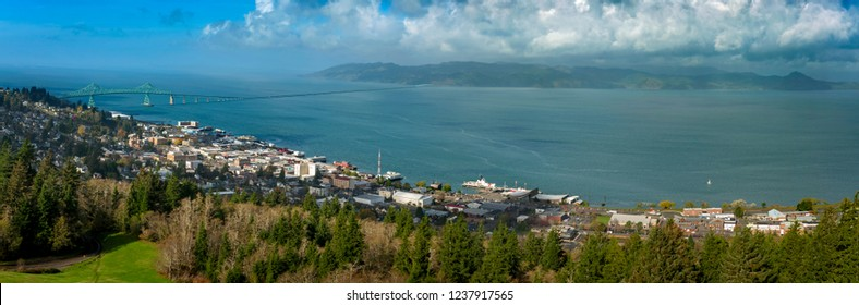 Historic Astoria, Oregon, USA. This view of the Astoria skyline is from the Astoria Column on a hill above the city featuring the beautiful Columbia River and the Astoria–Megler Bridge.