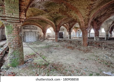 The historic barn with red brick and arched ceilings