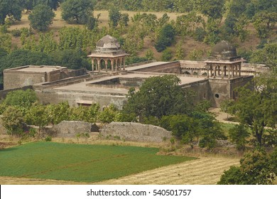 Historic Baz Bahadur's palace set in fields inside the hilltop fort of Mandu in Madyha Pradesh, India. Built in stages from 15th century onwards.