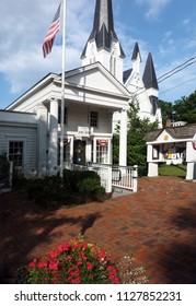 historic Bedford Village, New York post office and Bedford Presbyterian Church with American flag