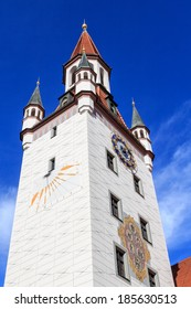 Historic bell tower with sundial in Munich, Germany