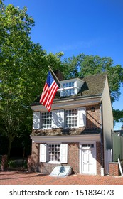 The historic Betsy Ross house tourism landmark with hanging American flag in Old City Philadelphia in Pennsylvania