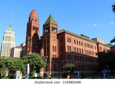 Historic Bexar County, TX Courthouse, built in 1896 with other buildings in Downtown San Antonio, TX