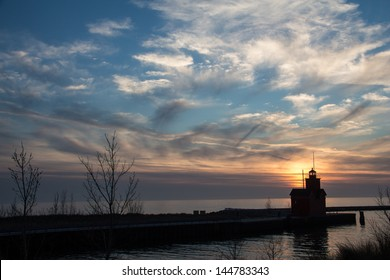 Historic Big Red Lighthouse silhouetted against a beautiful evening sky