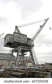 Historic Boston shipyard crane. Vertical.