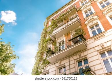 historic brick facade of living house in Berlin in summer