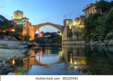 Historic bridge over the Neretva river in Mostar, Bosnia Herzegovina at twilight.