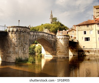 Historic bridge over a Tranquil River in Rural France
