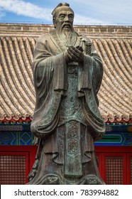 Historic Bronze Monument of Chinese Philosopher Confucius. Historic Bust of Ancient Chinese Wise Man.