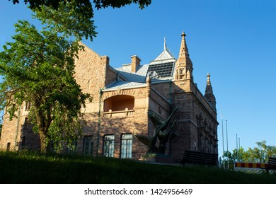 The historic building of an art museum built in 1904 on Puolalanmaki Hill in the city of Turku in Finland. The building of the museum in the style of Finnish romanticism on a summer day
