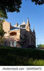 The historic building of an art museum built in 1904 on Puolalanmaki Hill in the city of Turku in Finland. The building of the museum in the style of Finnish romanticism on a summer day.
