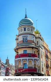 Historic building in the historic center of Seville, Spain with decorations for Holy Week