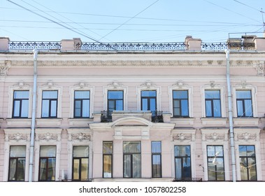 Historic Building Facade in St. Petersburg, Russia. Renovated Old Architecture, Front View of Classic Historical Modern Apartment Building with Several Windows in Row. Building Exterior Design Image.