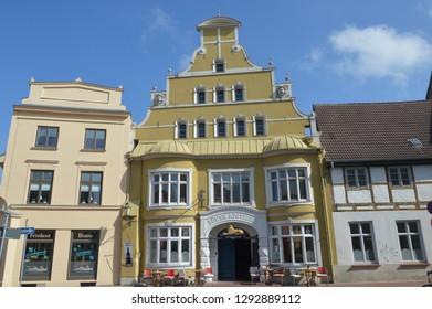Historic building facades. Drugstore and deli. Wismar, Mecklenburg Western Pomerania, Germany. April-30-2017