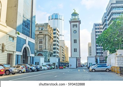 The historic building of the lighthouse, nowadays located among the high-rises of the Fort district and functioning as the clock tower, Colombo, Sri Lanka.