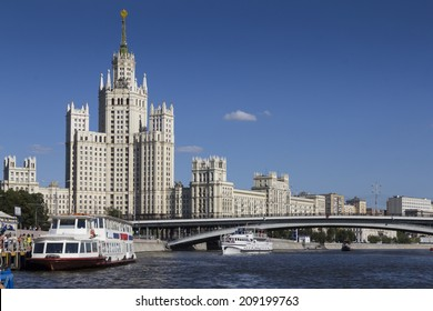 Historic building on the banks of the Moscow River. Ships with tourists.