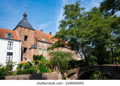 historic building in street Muurhuizen, along canal in Amersfoort, The Netherlands