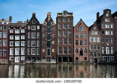 Historic buildings along canal in Amsterdam