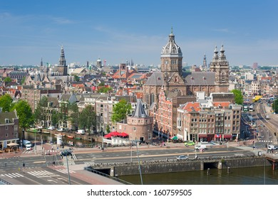 Historic buildings in the center of Amsterdam in a sunny summer day