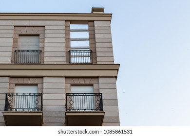 Historic buildings in the city center and apartments with windows and balconies.